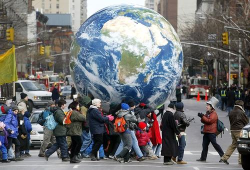 Antiwar protestors carry an inflatable globe through New York City as part of the massive, worldwide protests of February 15, 2003 opposing the Bush administration's drive towards war in Iraq